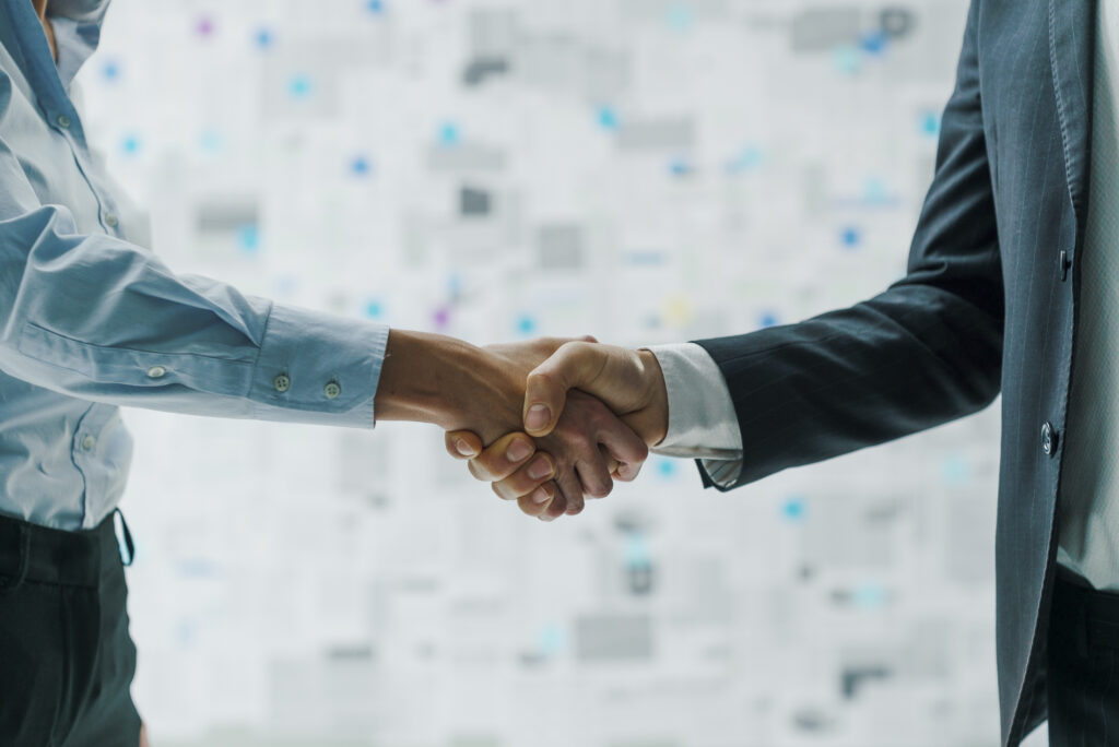 Business partners shaking hands | RTX